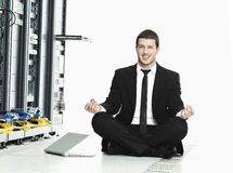 Business man practice yoga in network server room stock photo