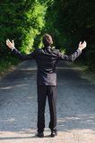 Business man pray. On road Stock Images