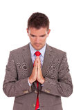 Business man praying Stock Photography
