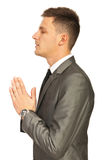 Business man praying Stock Photo
