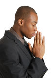 Business man praying with eyes closed Stock Images