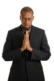 Business man praying with eyes closed Royalty Free Stock Photos