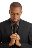 Business man praying with eyes closed Royalty Free Stock Images