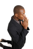 Business man praying on his knees Royalty Free Stock Photography