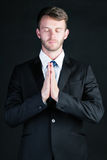 Business man praying Royalty Free Stock Images