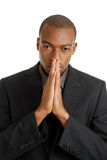 Business man praying using prayer gesture eyes ope Stock Photos