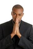 Business man praying using prayer gesture eyes ope Stock Photos