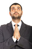 Business man praying and wishing Royalty Free Stock Photography