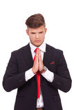 Business man praying Royalty Free Stock Image