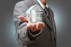 Business man present  diamond house model Royalty Free Stock Photos