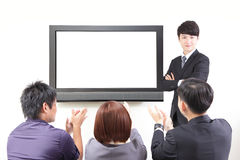 Business man presentation to colleagues with TV Royalty Free Stock Photo
