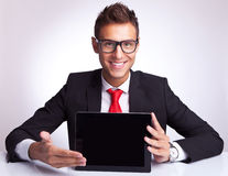 Business Man Presenting A Touchscreen Pad Royalty Free Stock Photography