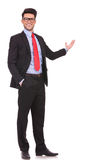 Business man presenting in the back Royalty Free Stock Photo