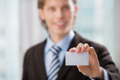 Business man presenting a blank business card Stock Images