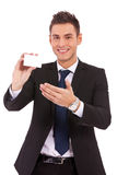 Business man presenting a blank card or note Stock Photo