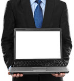Business man presenting blank laptop Stock Photo