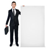 Business man presenting empty board Royalty Free Stock Images