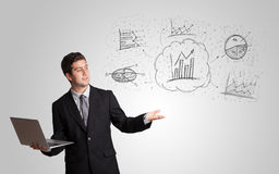 Business man presenting hand drawn sketch Royalty Free Stock Photos