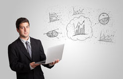 Business man presenting hand drawn sketch graphs and charts. Concept Royalty Free Stock Image