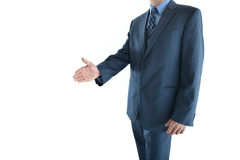 Business man presenting or holding out hand for handshake Royalty Free Stock Images