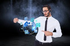 Business man presenting icons and wearing Headset Royalty Free Stock Image