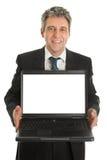 Business man presenting laptopn Royalty Free Stock Photos
