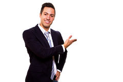 Business man presenting over a white background Stock Photography