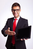 Business man presenting pad Royalty Free Stock Image
