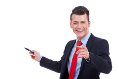 Business man presenting and pointing. Young business man presenting something at his back and pointing to you stock images