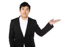 Business man presenting and showing Stock Photography
