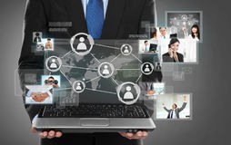 Business man presenting social network connection. Businessman holding a laptop pc and surfing in the social network connection stock illustration
