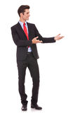 Business man presenting something or inviting stock photos