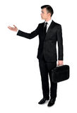 Business man presenting something. Isolated business man presenting something Stock Photography
