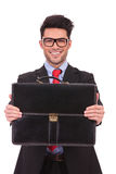Business man presents briefcase Stock Images