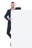 Business man presents empty board Royalty Free Stock Photo