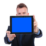 Business man presents empty screen tablet Stock Photography