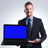 Business man presents his laptop Stock Photography