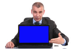 Business man presents his laptop Stock Image