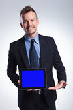 Business man presents his new tablet Royalty Free Stock Photography
