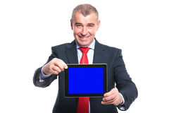 Business man presents his tablet Royalty Free Stock Images