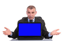Business man presents laptop with blue screen Stock Photography