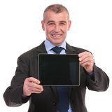 Business man presents a tablet Royalty Free Stock Image