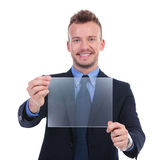 Business man presents transparent screen Royalty Free Stock Photos