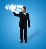 Business man pressing button Stock Images