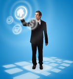 Business man pressing button Stock Photos