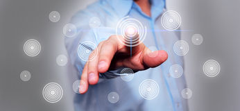Business man pressing a  button. Business man pressing a touchscreen button Stock Images