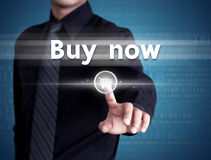 Business man pressing buy now icon. Business man pressing buy now on shopping cart icon Stock Image