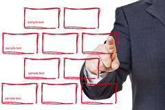 Business man pressing designed buttons Stock Image