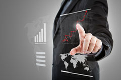 Business man pressing high tech graph. Royalty Free Stock Images