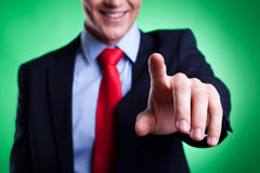 Business man pressing an imaginary button Stock Image